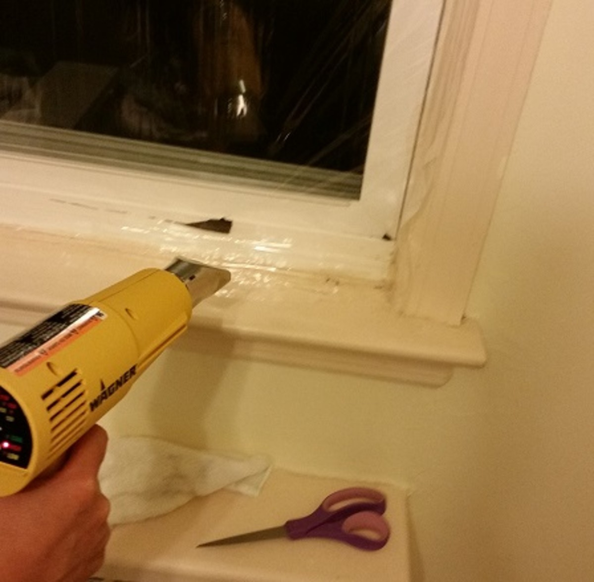 Use the heat gun to tightly fit the plastic shrink wrap to the window / window space.