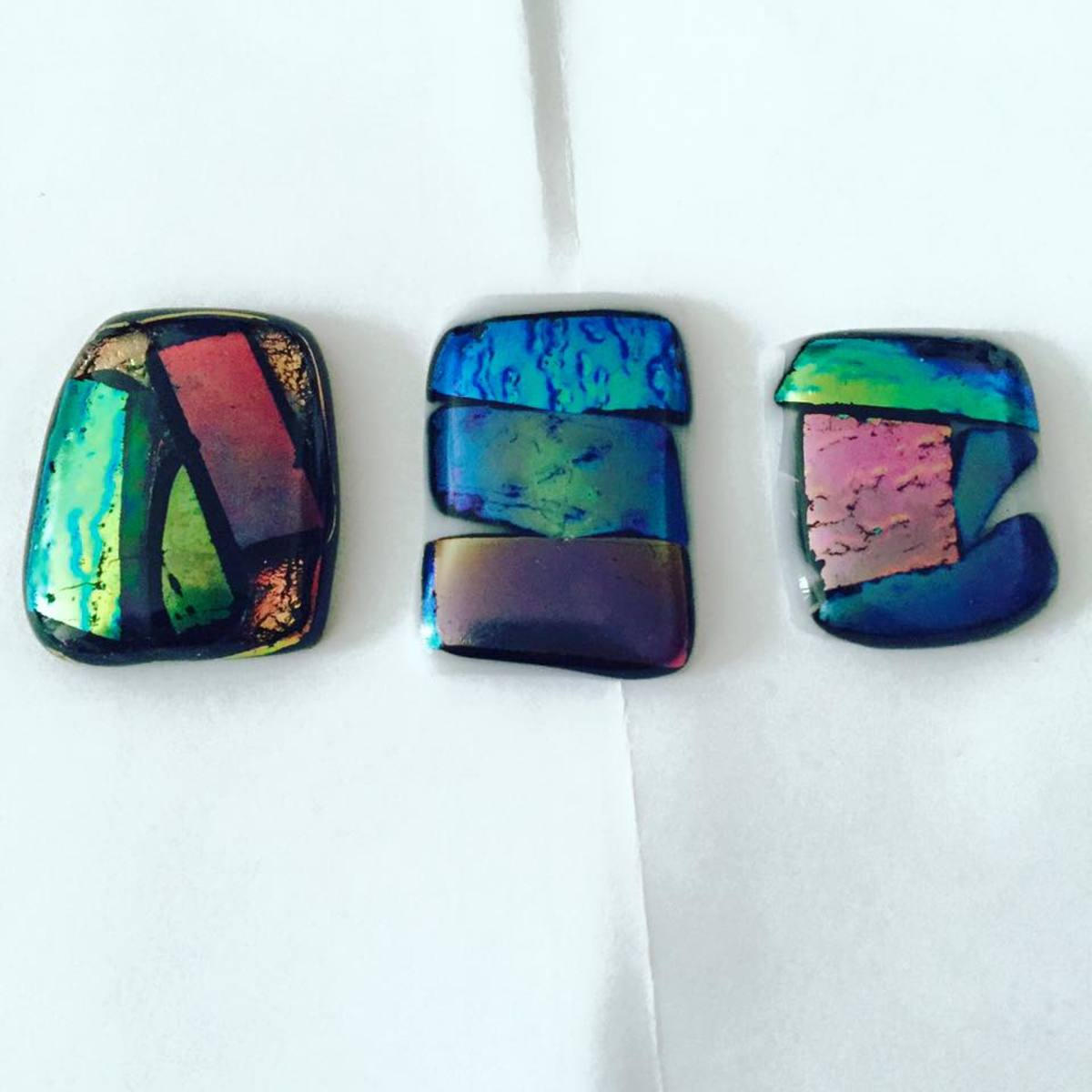 These are among the very first pendants I made in my microwave kiln! As you can see, they're very simple: just pieces of glass laid of against black or white backgrounds (base glass).