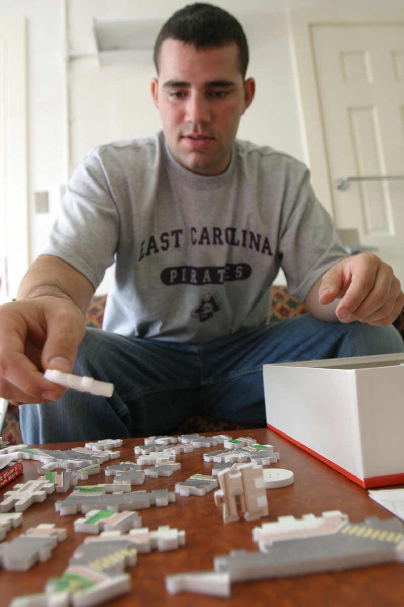 This wounded army veteran took brain injury in while serving his country. He helps his to improve his hand/eye coordination and memory by playing video games and piecing together puzzles, like this 3D puzzle of the White House.