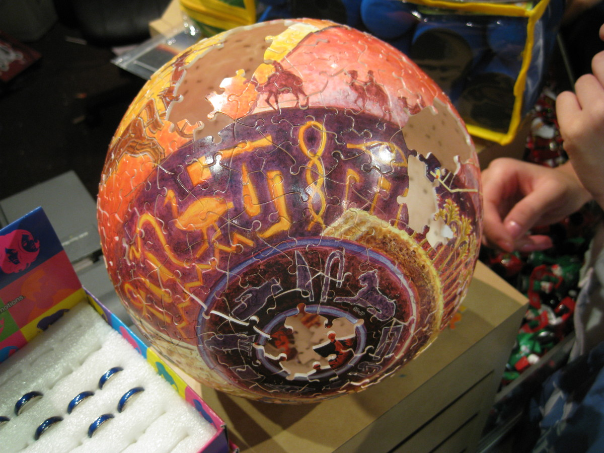 A spherical 3D puzzle in the process of being made.