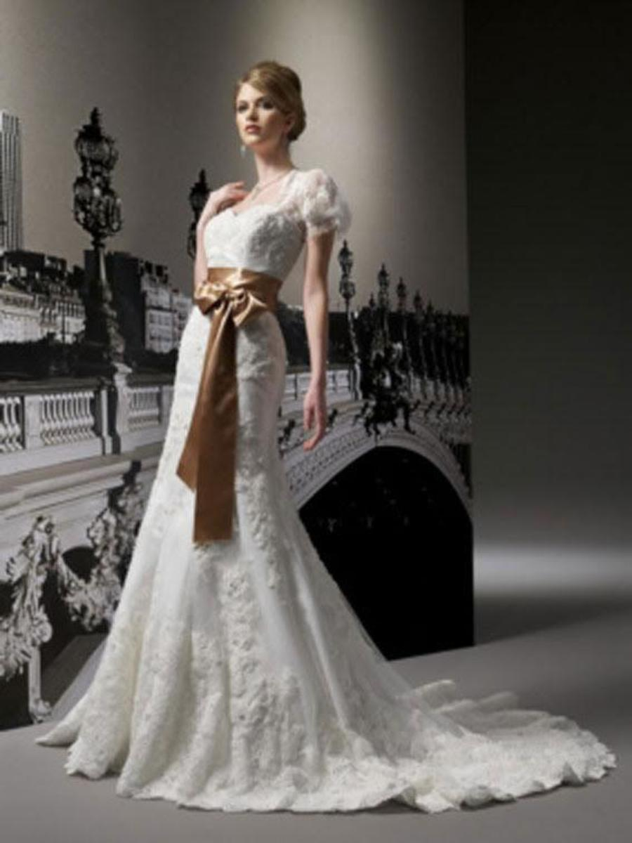 Column style wedding dress that flares out at the bottom.