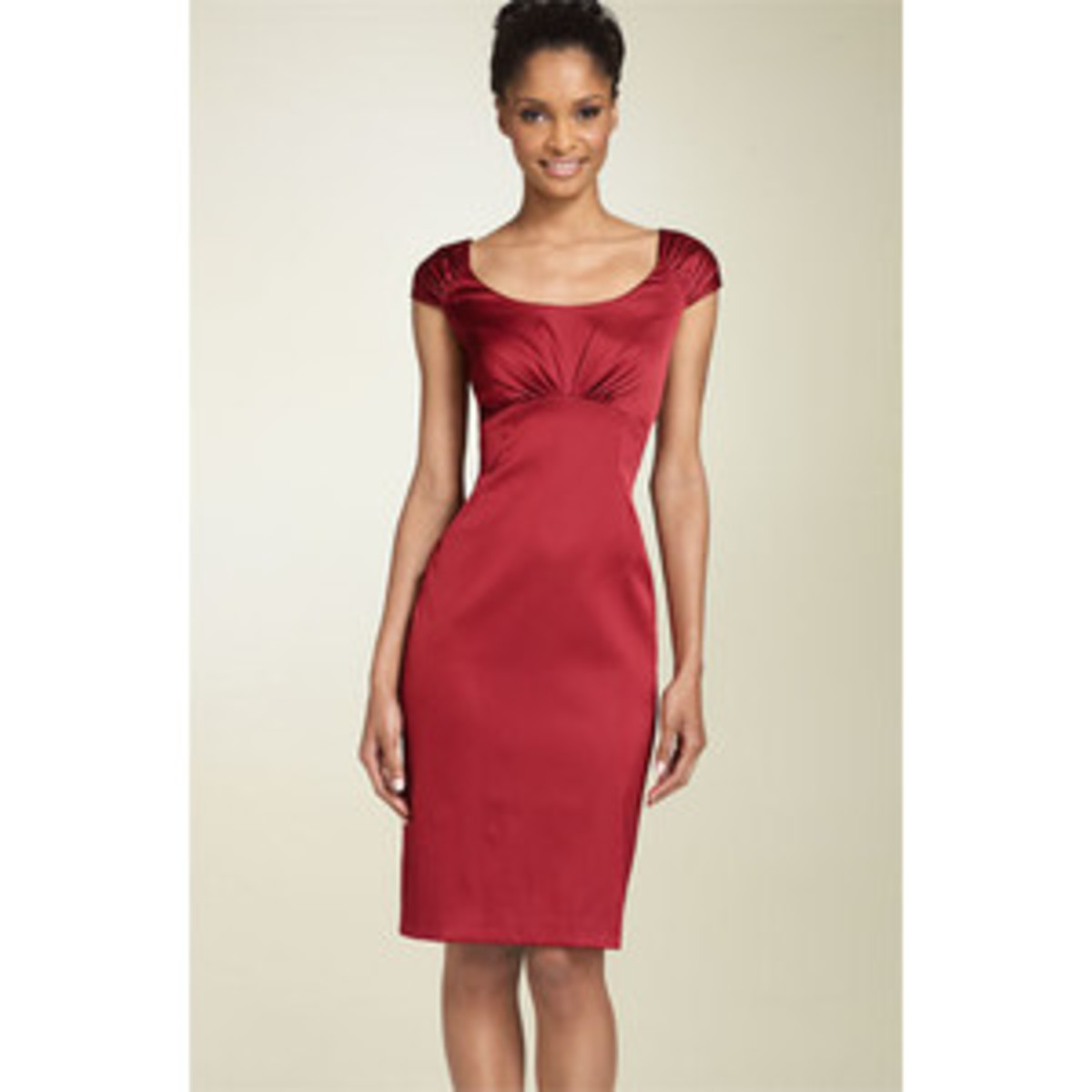 This sheath is good for hourglass figures, but a pear would also look great in this because of the beautiful roching across the bust.