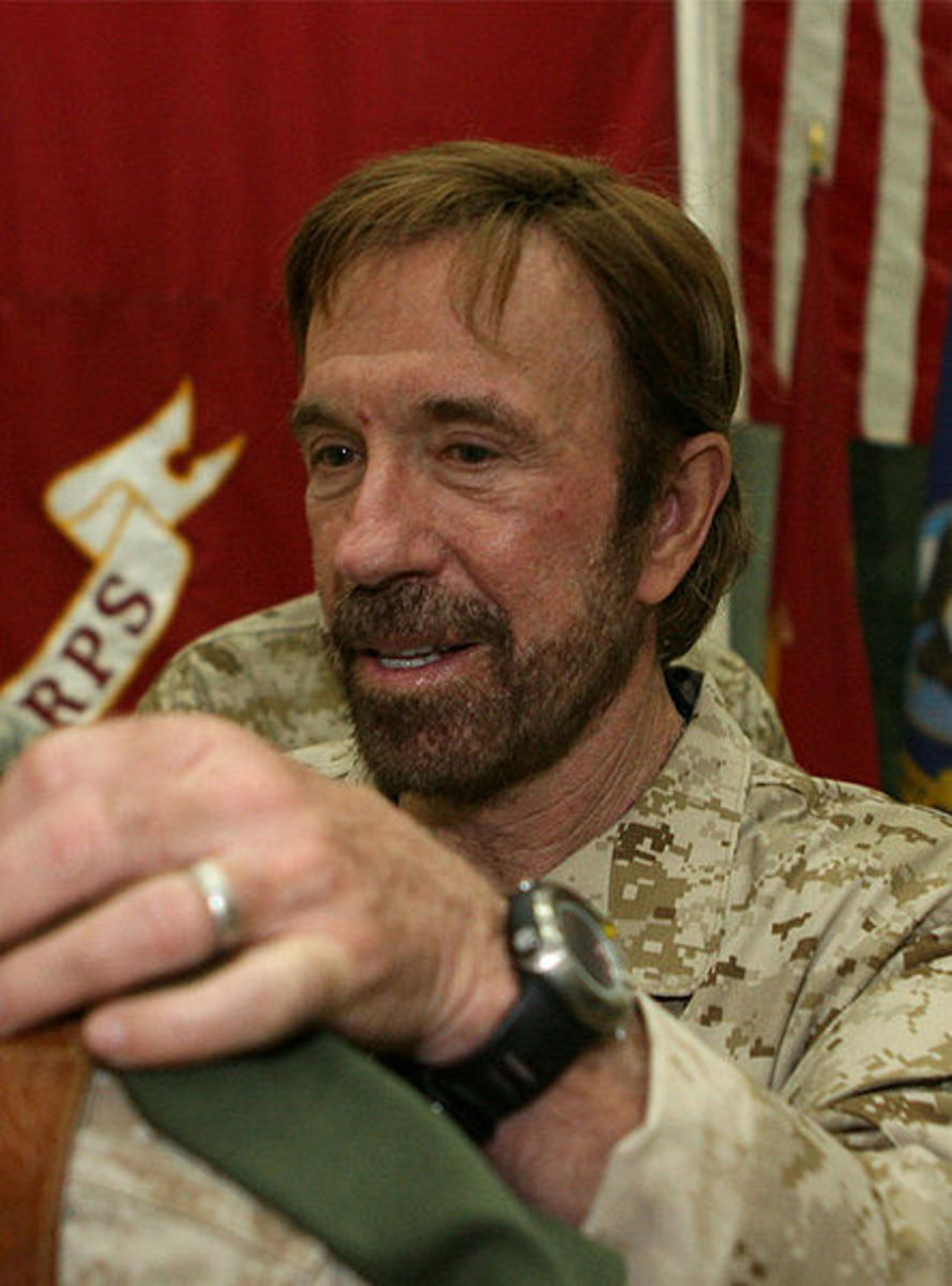 Chuck Norris signs a T-shirt for Corporal William P. Kessler, 23 of Cedar Park, Texas.  Chuck Norris was one among many who toured Iraq, uplifting the hearts of our honored Americans in the service.