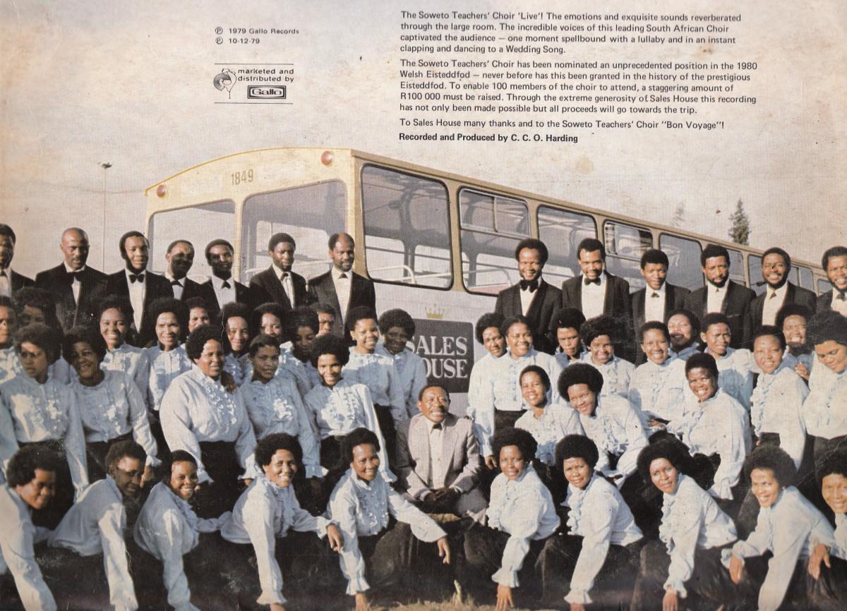 Soweto Teachers Choir posing for a photo next to Putco bus