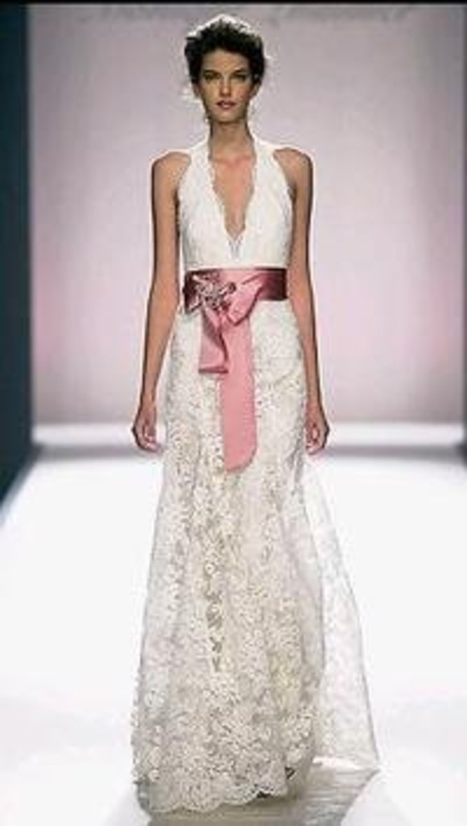 Monique Lhuillier is known for her sexy and elegant wedding dresses