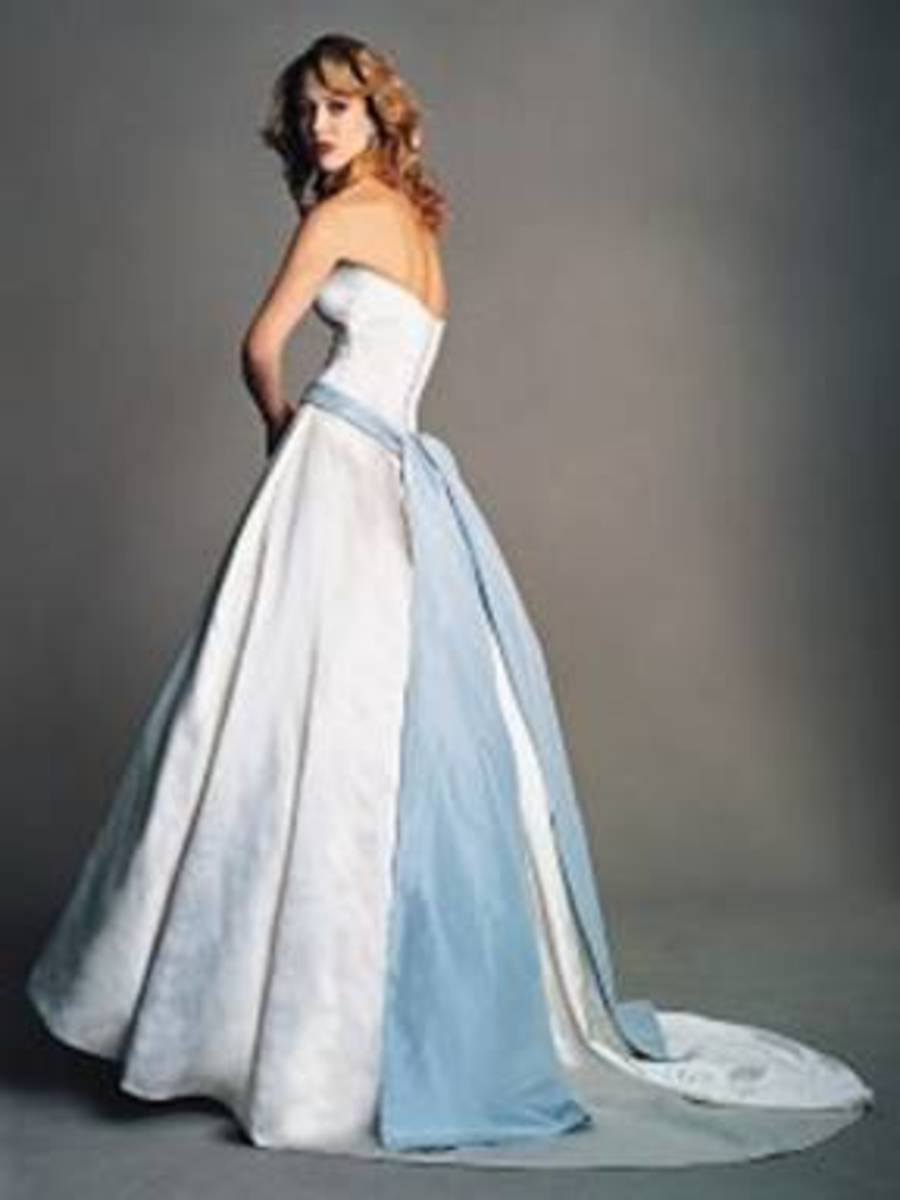 Amsale's iconic strapless bridal gown with blue sash