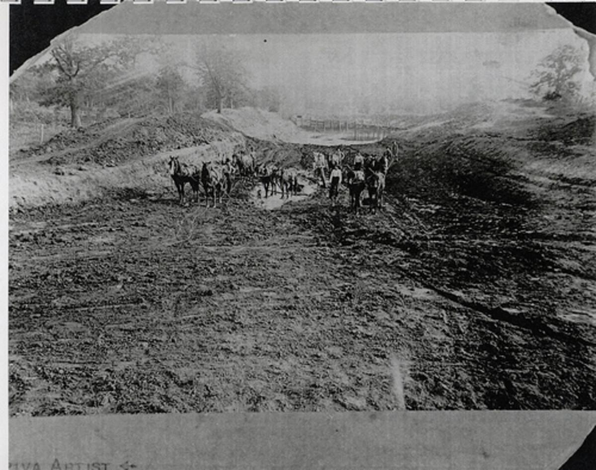 Farmers plowing in 1892.