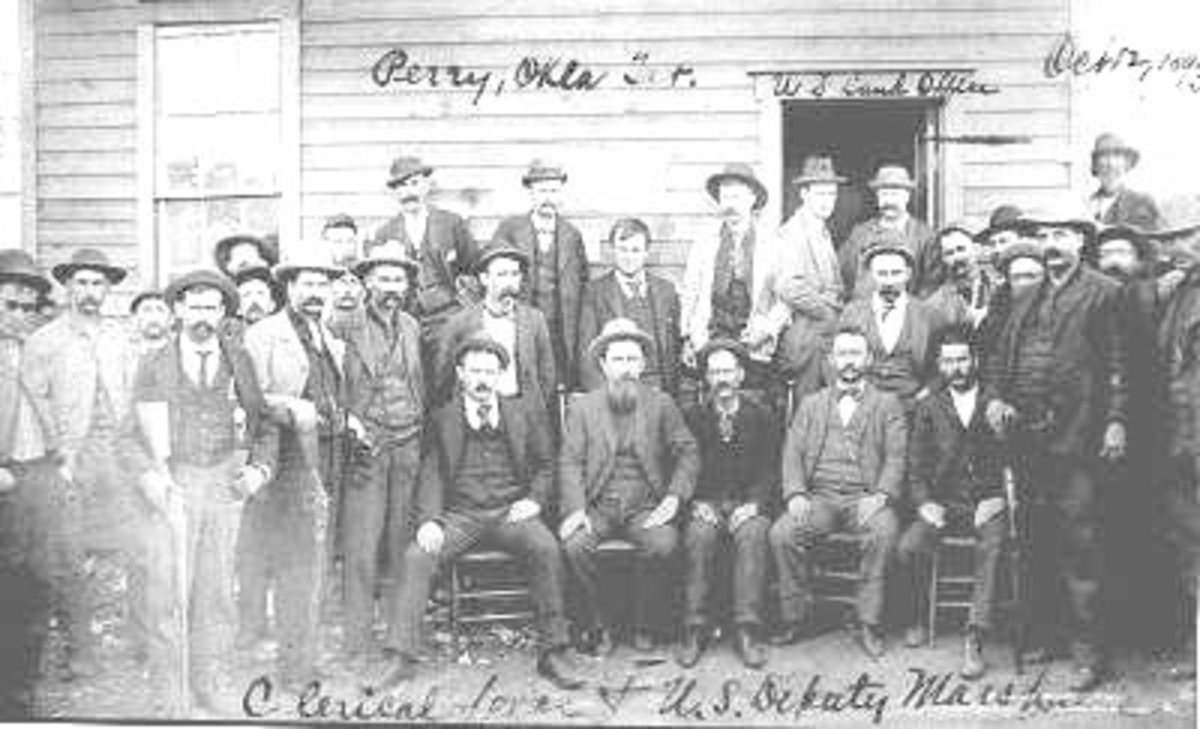 A lot of business was done in 1889 out of a city office.Here you see the U.S. Land Office, the clerical staff and the U.S Marshalls.