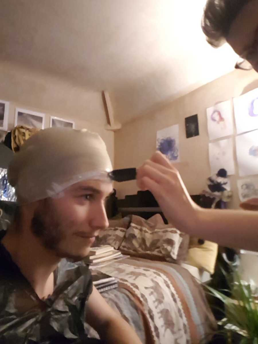 Placing the bald cap unto the model using latex