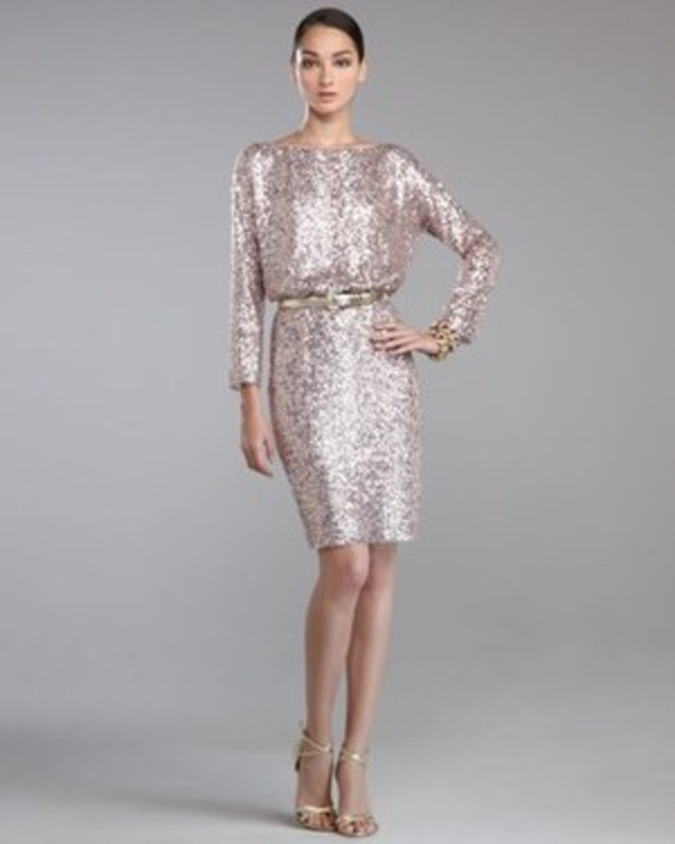 Sequined knit. Bateau neckline. Dropped shoulders. Bracelet sleeves. Blouson bodice. Pencil skirt. Hem hits above the knee. Polyester. Imported.