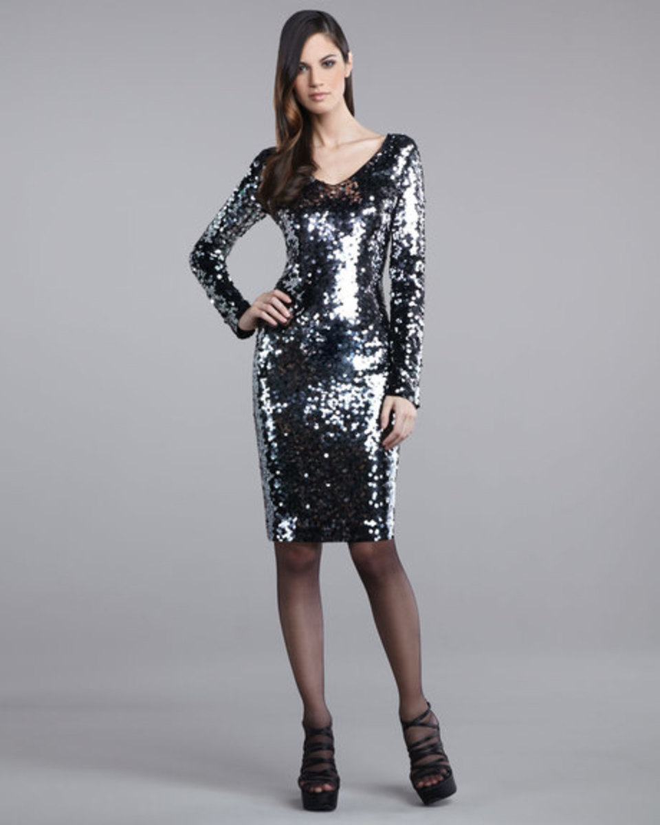 sequined knee length gown by St. John in silver with long sleeves