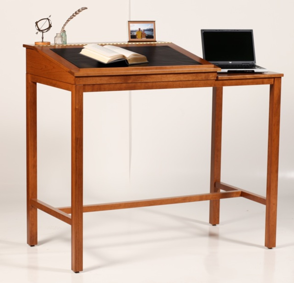 Standupdesks.com has some beautiful designs! This one is fashioned after the stand up desk Ernest Hemingway used. (http://www.standupdesks.com/hemingway.shtml)