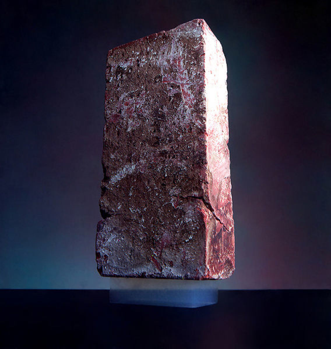 Aerogel supporting a brick. Image source WikiCommons.