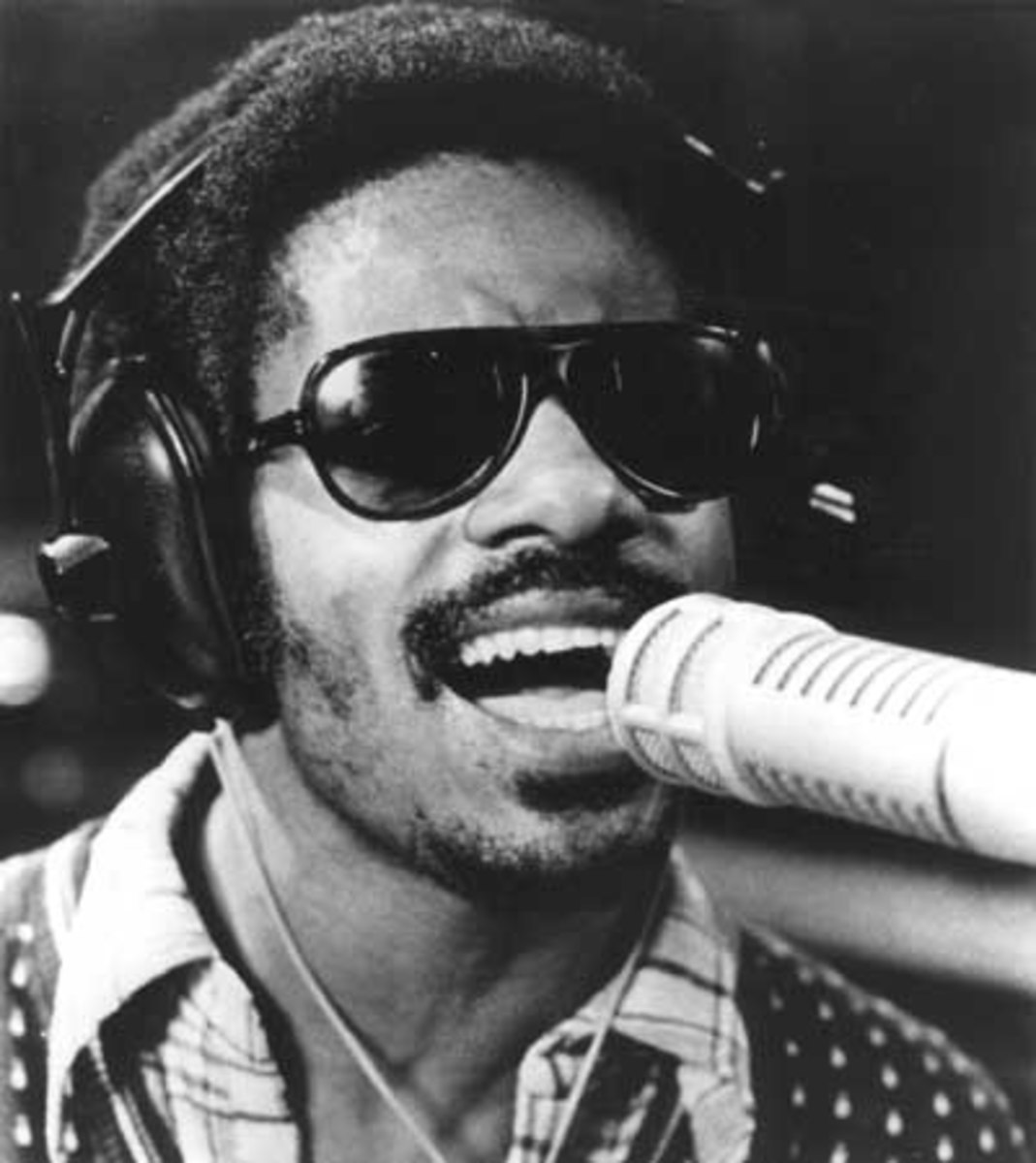 Stevie Wonder, an American singer-songwriter, multi-instrumentalist and record producer (1950)