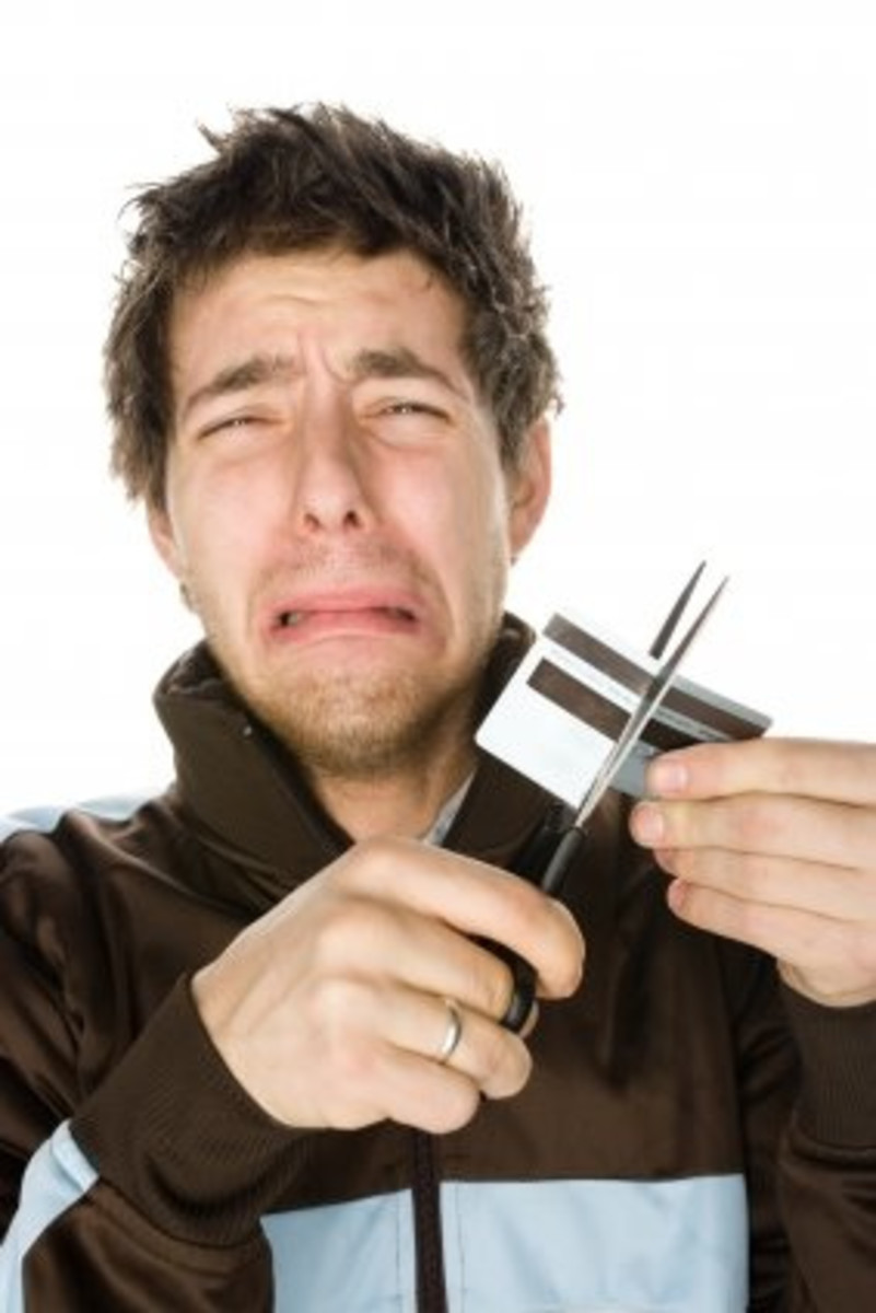 Don't cry, just cut your credit card into pieces to live happily