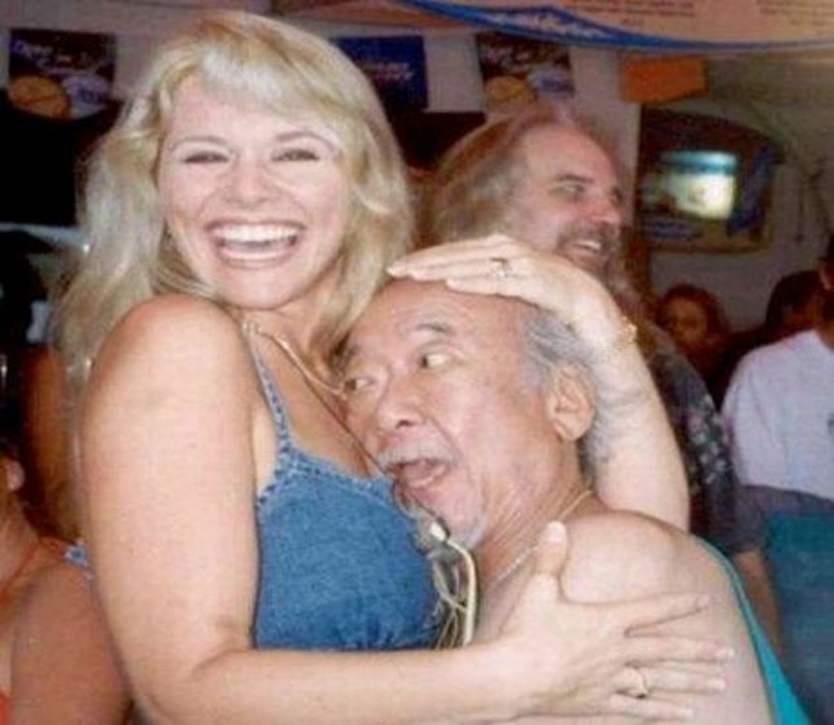 This old man with sexy blonde has thrown away his credit cards. Look how happy he is after getting out of debts.