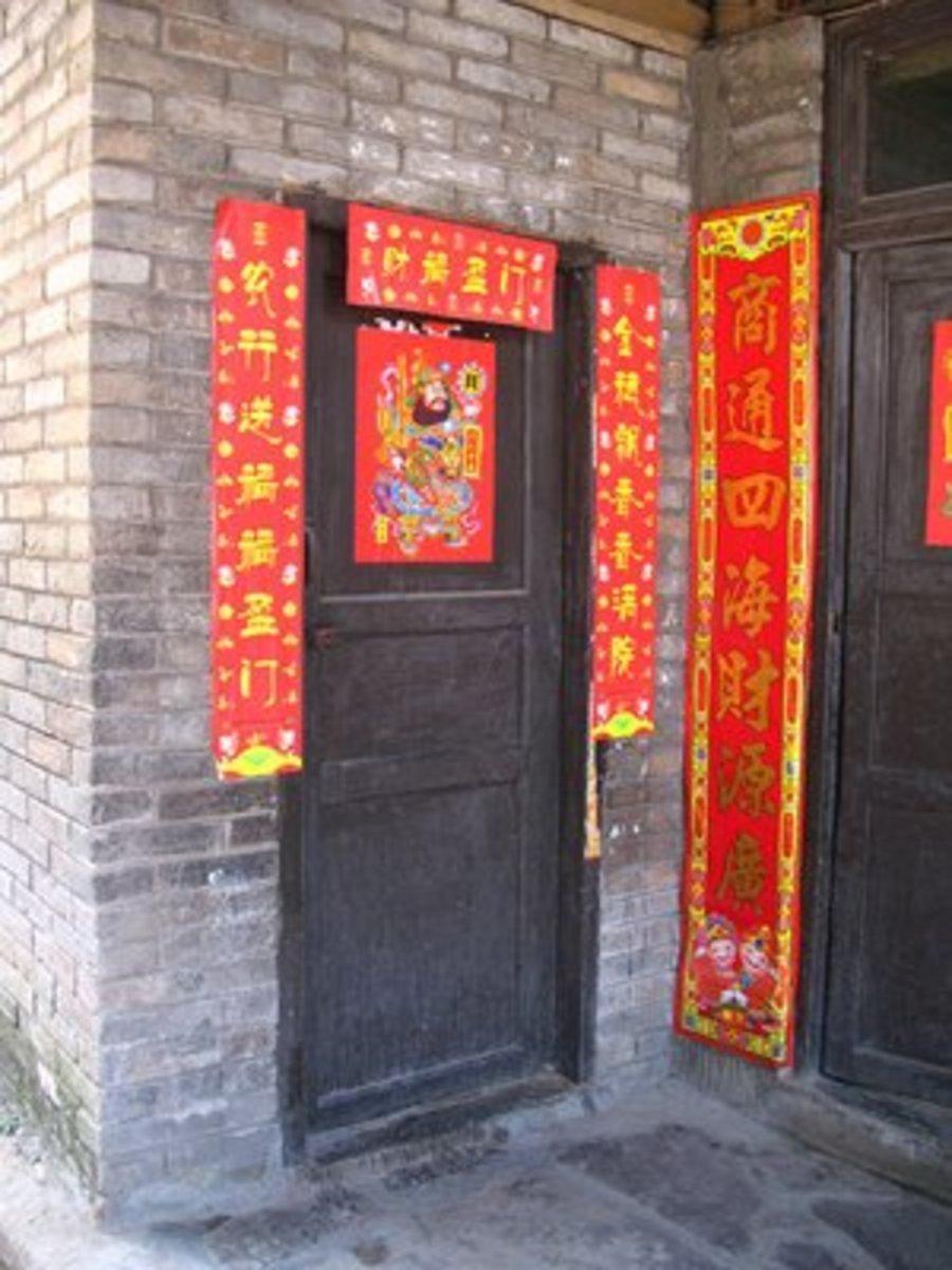 RED COUPLETS usually displayed on the door of houses