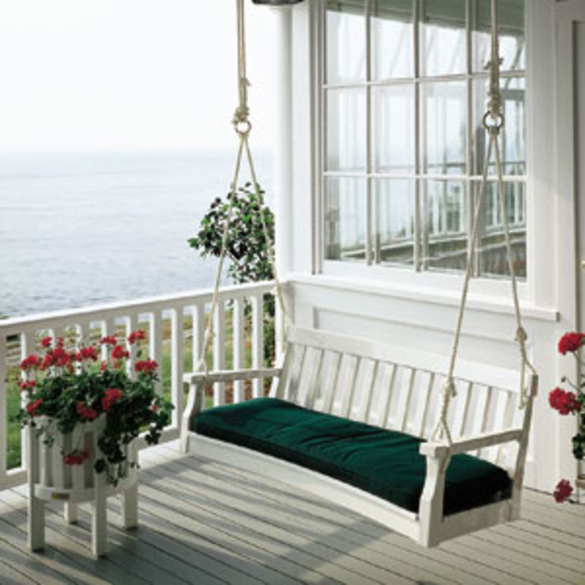 Add a front porch swing with a colorful cushion!
