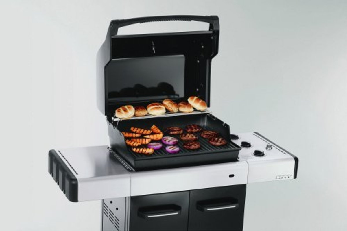 Weber Spirit barbecues come standard with porcelain coated steel cooking grates and a one year warranty.  Most clients will purchase stainless cooking grates one year later.