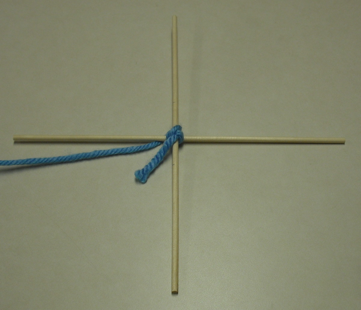 Secure Dowels by Tightly Wrapping Around Intersection in a Crossed Pattern