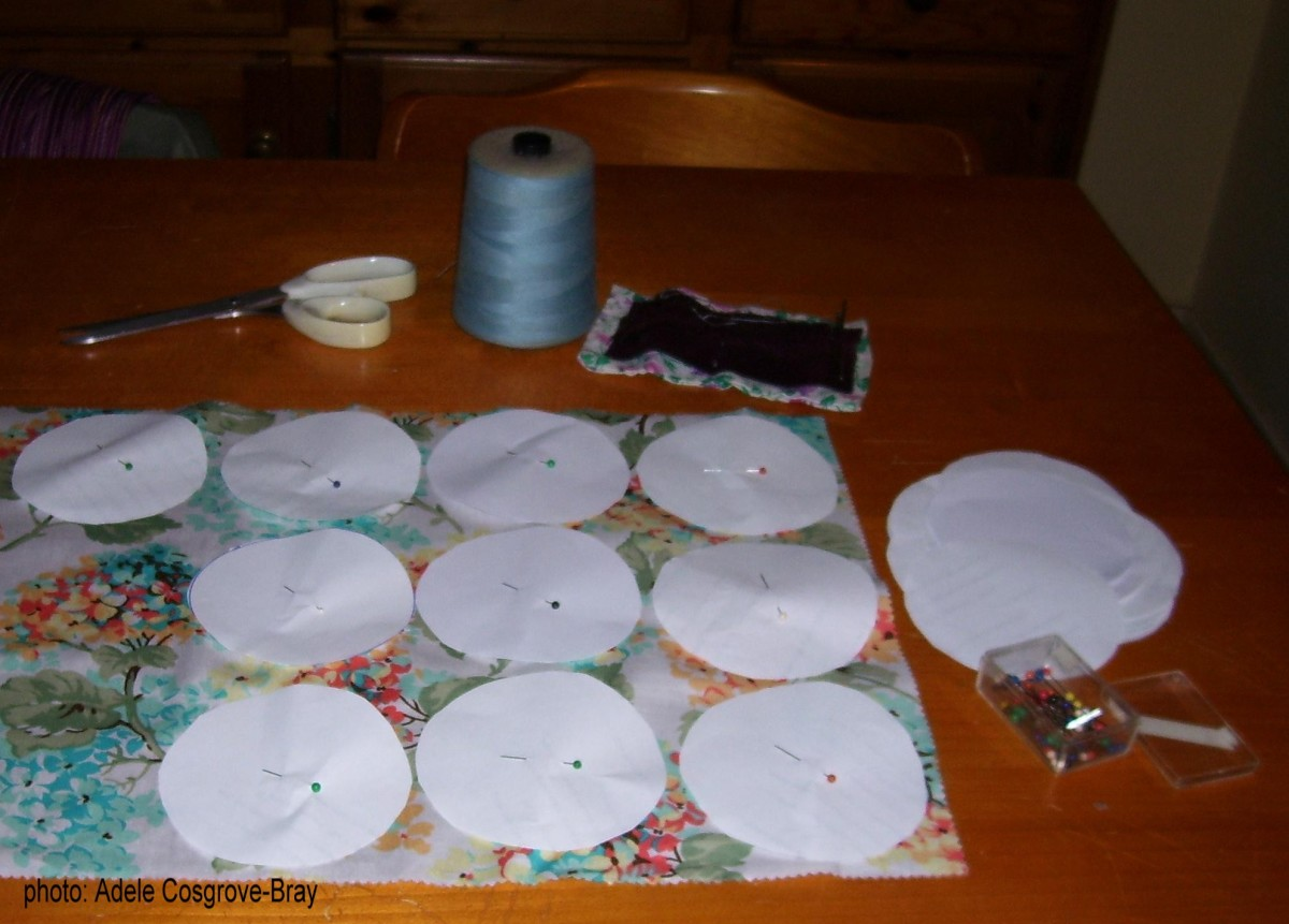 Pinning paper disks to fabric.
