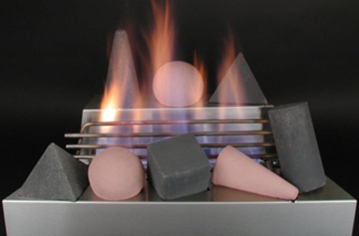 Burning fire shapes in a ventless gas log fireplace with stainless steel burner.