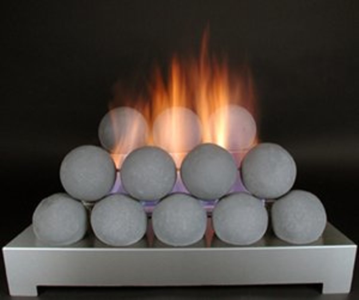 Vent free gas logs without ceramic logs take various shapes, including fire balls often referred to as cannonball fires.
