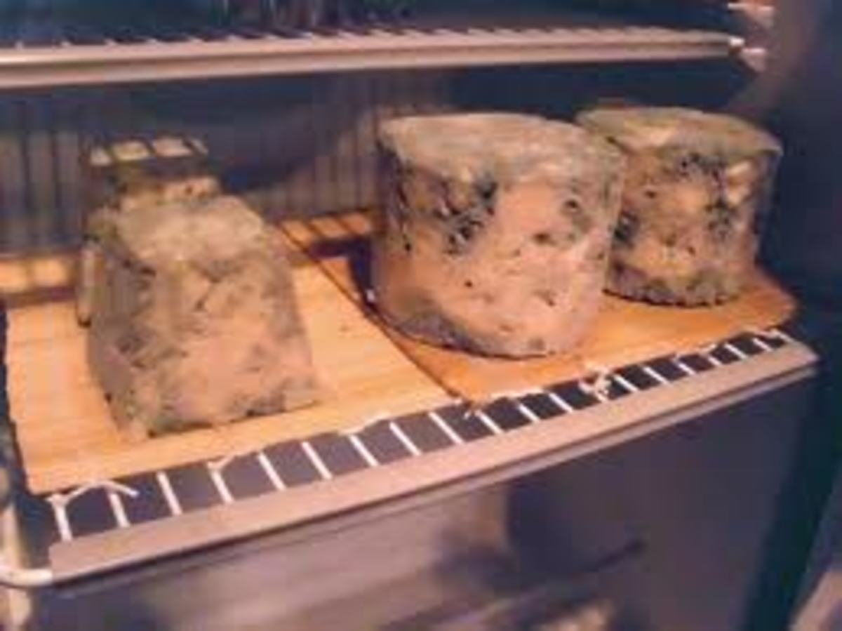 Place the pierced cheese on a flat plate or rack that has been topped with a cheese mat. Place the cheese in a cool room or refrigerator. The cheese pictured here shows some maturity and age and is in a variety of shapes and pounds.