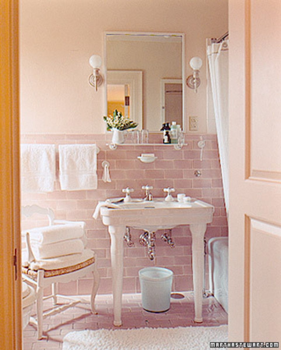 Martha Stewart's version of a vintage pink bathroom.  Old charm with a few modern twists like pink subway tiles.