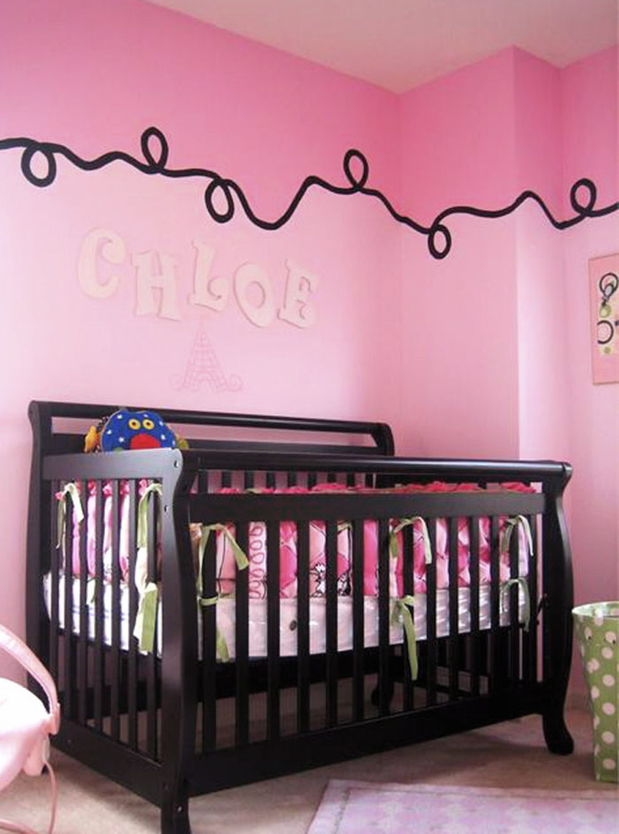black and pink stylist nursery with creative ceiling border
