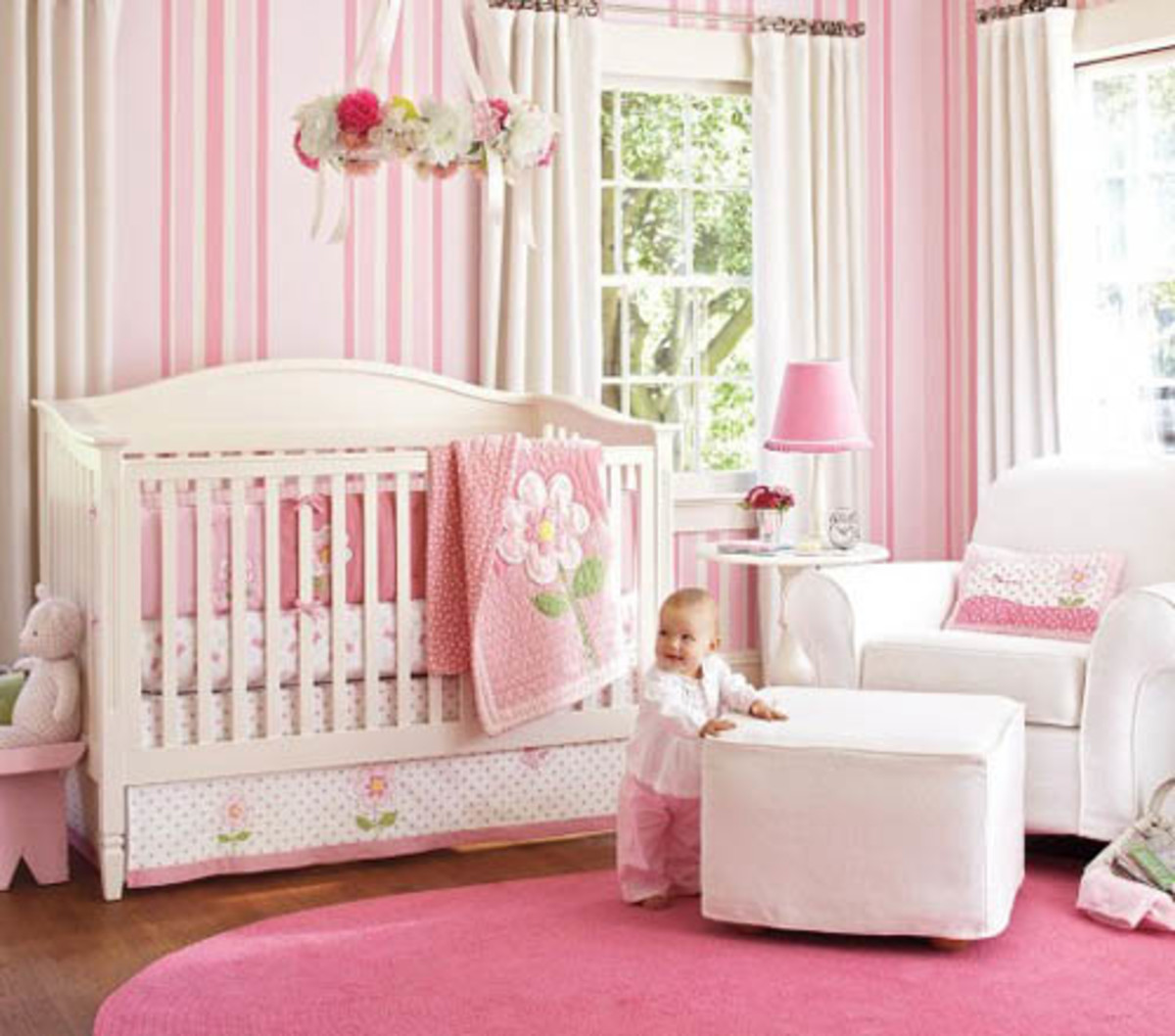 striped pink wallpaper in babies nursery