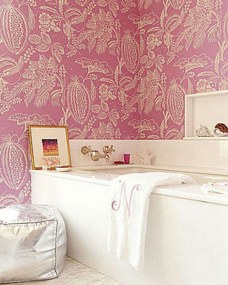 Space is organized more traditionally by Amanda Nesbit, who wrapped a cerise melon-pattern Manuel Canovas wallpaper around a bathtub, evoking youthful energetic passion and a romantic garden.  Nesbit always uses bright pink well and here, plays up th