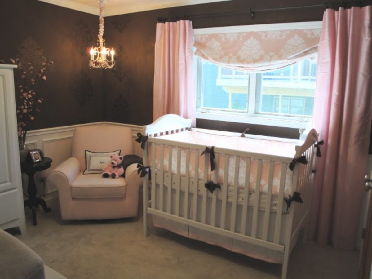nursery with brown walls and pink accents