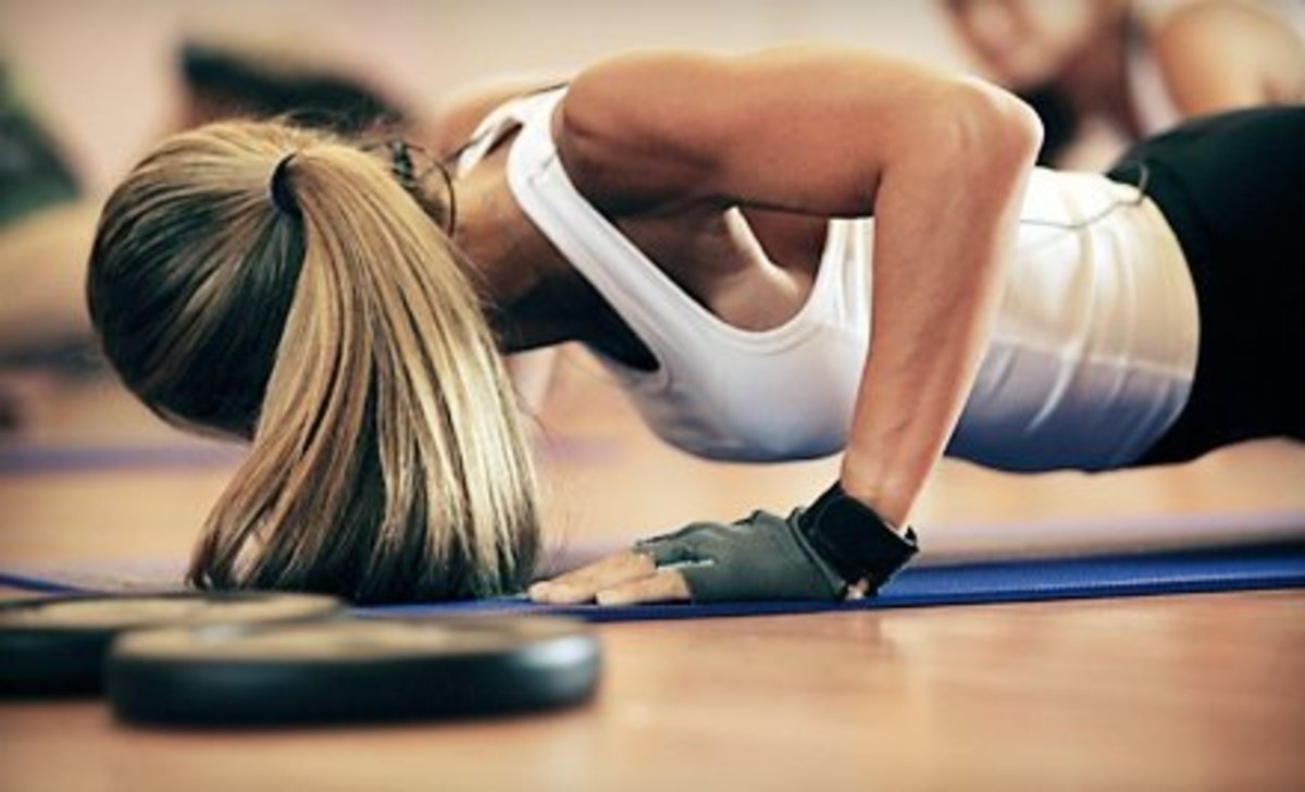 fitness pumping with push ups girl with ponytail and white shirt