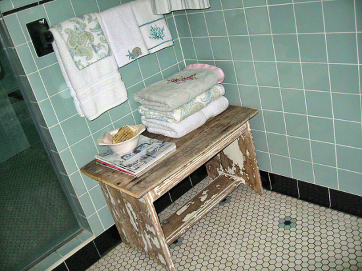 Example of a distressed bathroom table in a shabby chic style setting