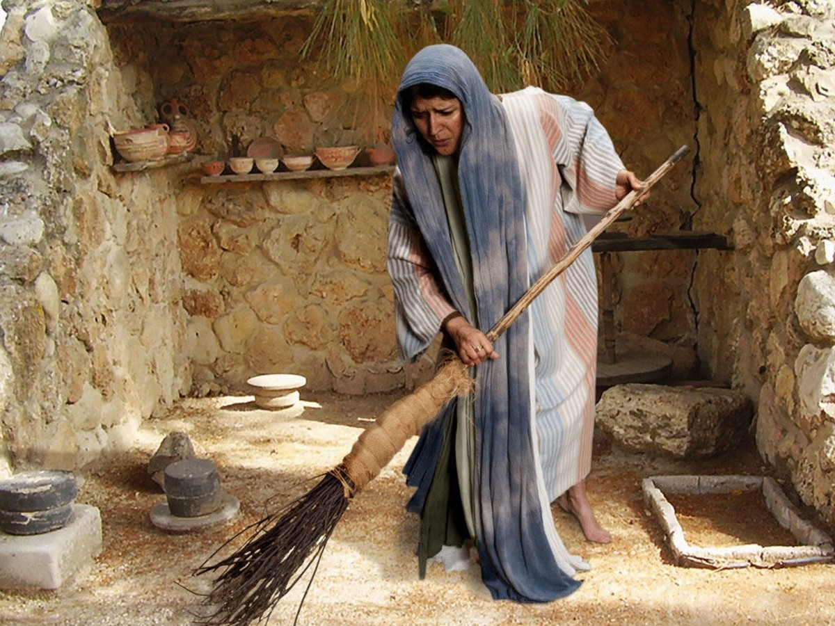 The woman sweeps her dirt floor trying to find her lost coin.