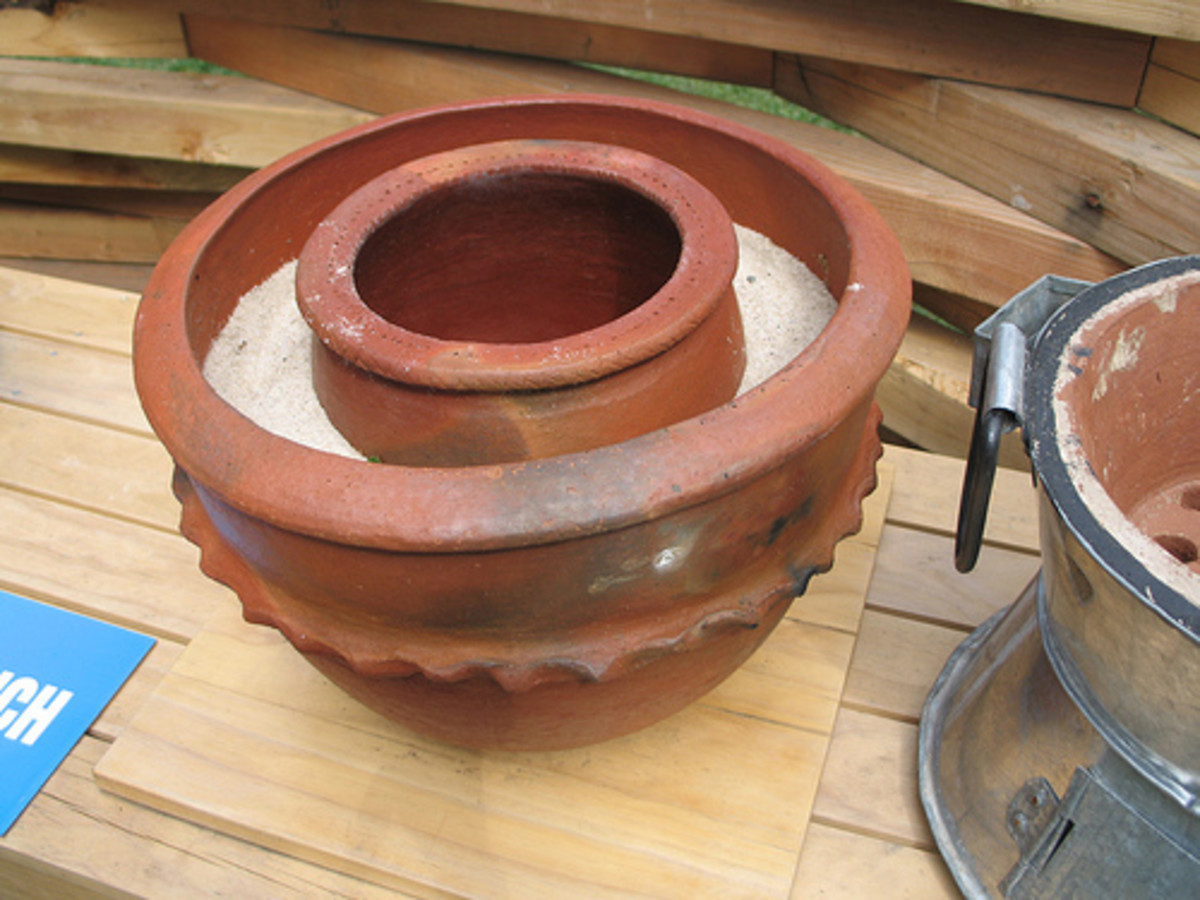 Passive cooling using a zee or zeer pot is accomplished with a double walled vessel made of bisque ware of earthenware the space between the pots is filled either with water of damp sand, A lid (not shown) keeps it cool inside. These can be large