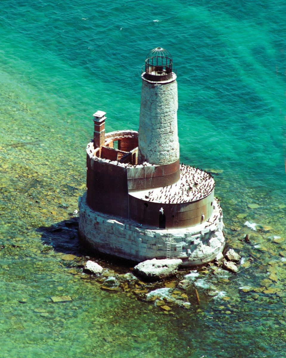 This image of Waugoshance Lighthouse shows the treacherous waters surrounding it.