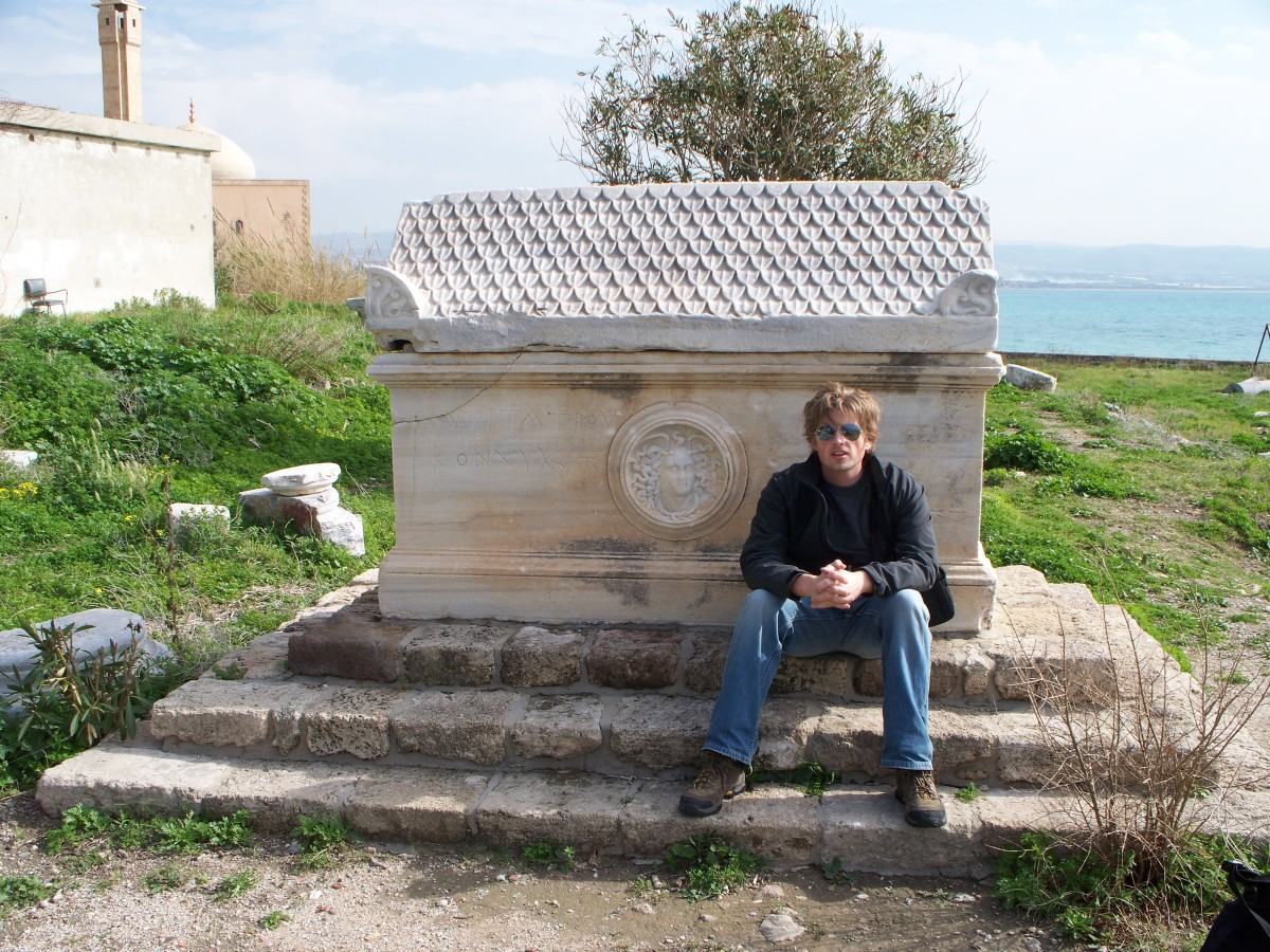 The author resting next to a sarcophagus on the site of Tyre