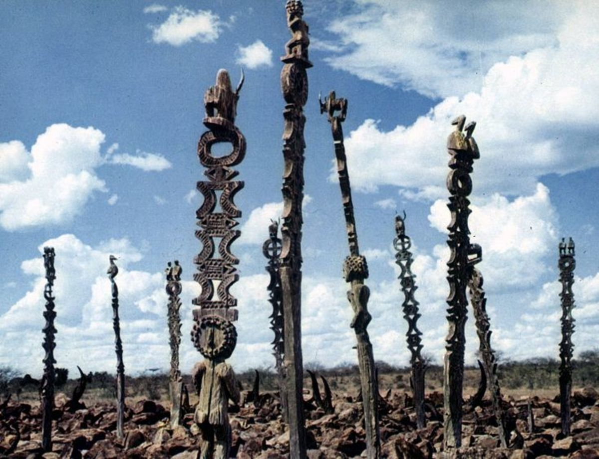 Funeral poles in Madagascar mark many graves.