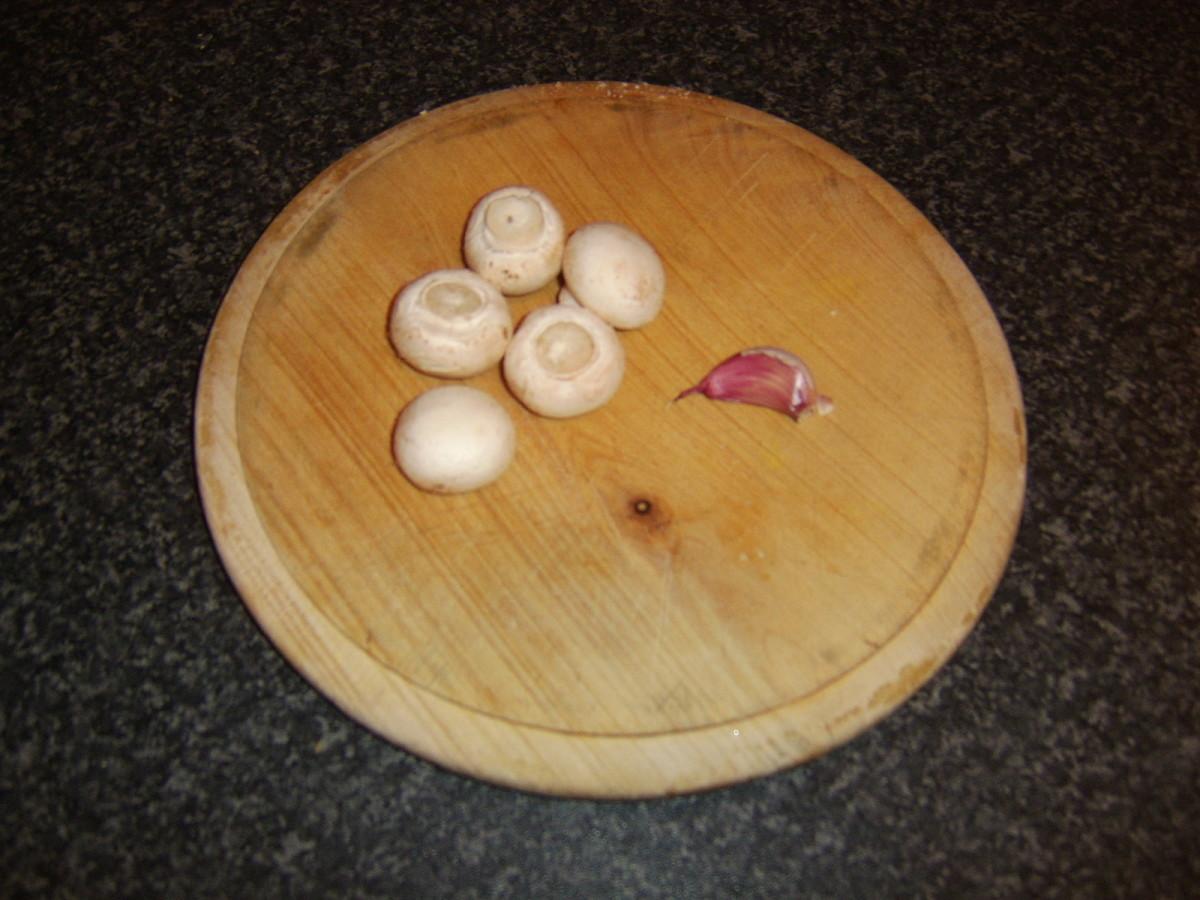 Button mushrooms and garlic clove
