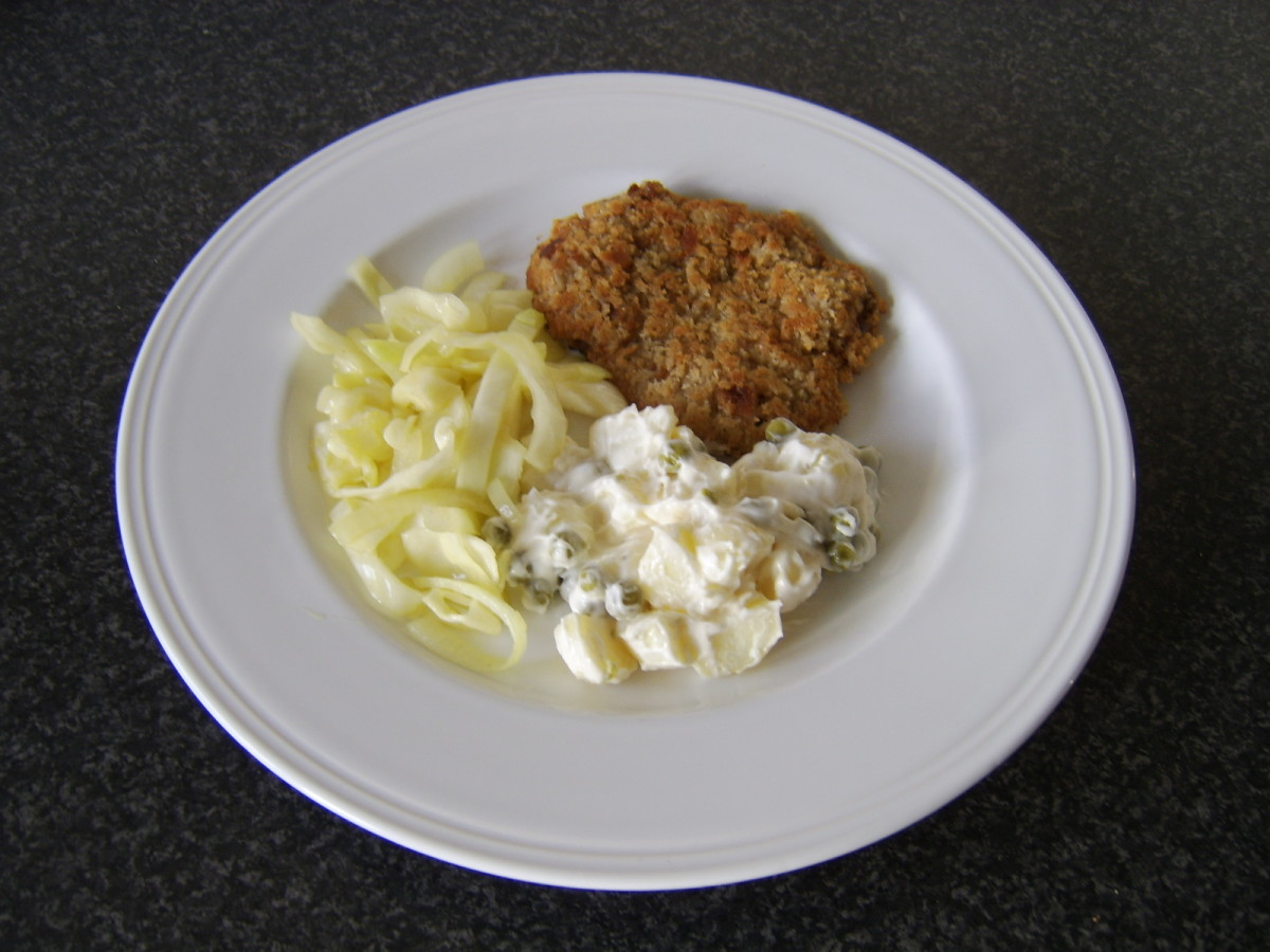 Wienerschnitzel, potato salad and cabbage ready for the mushroom sauce