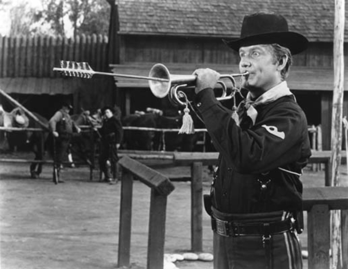 Bugler Hannibal Dobbs...this guy never hit the right notes! Maybe the arrow stuck in his bugle will help.