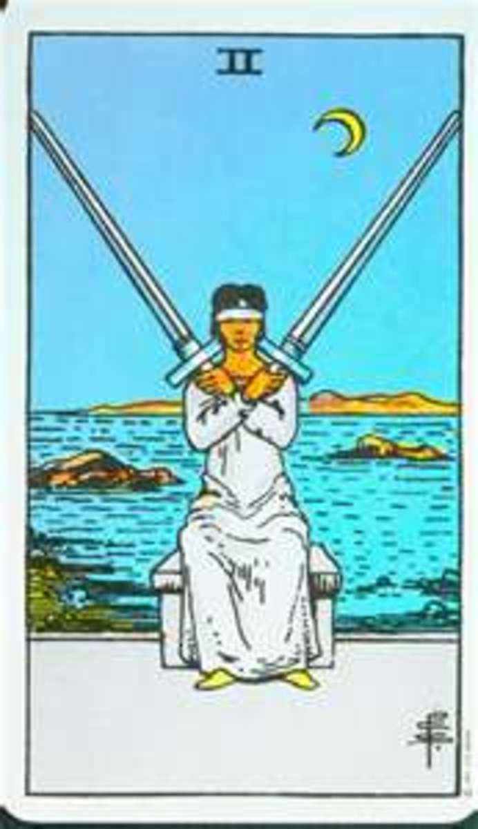 Tarot Card Combinations: Two of Swords & Reversed Three of Cups