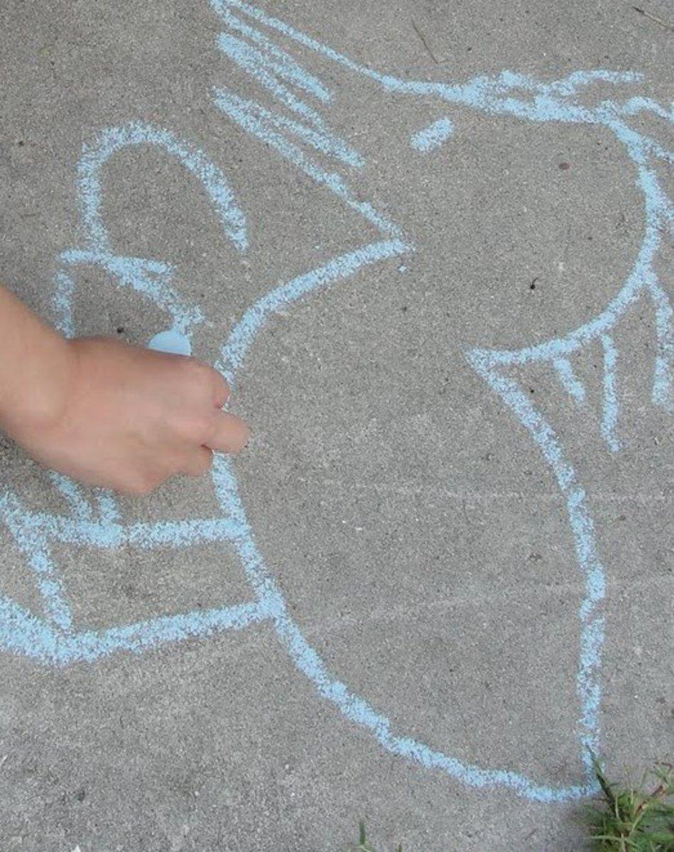 Pueblo-style chalk drawing using sidewalk chalk