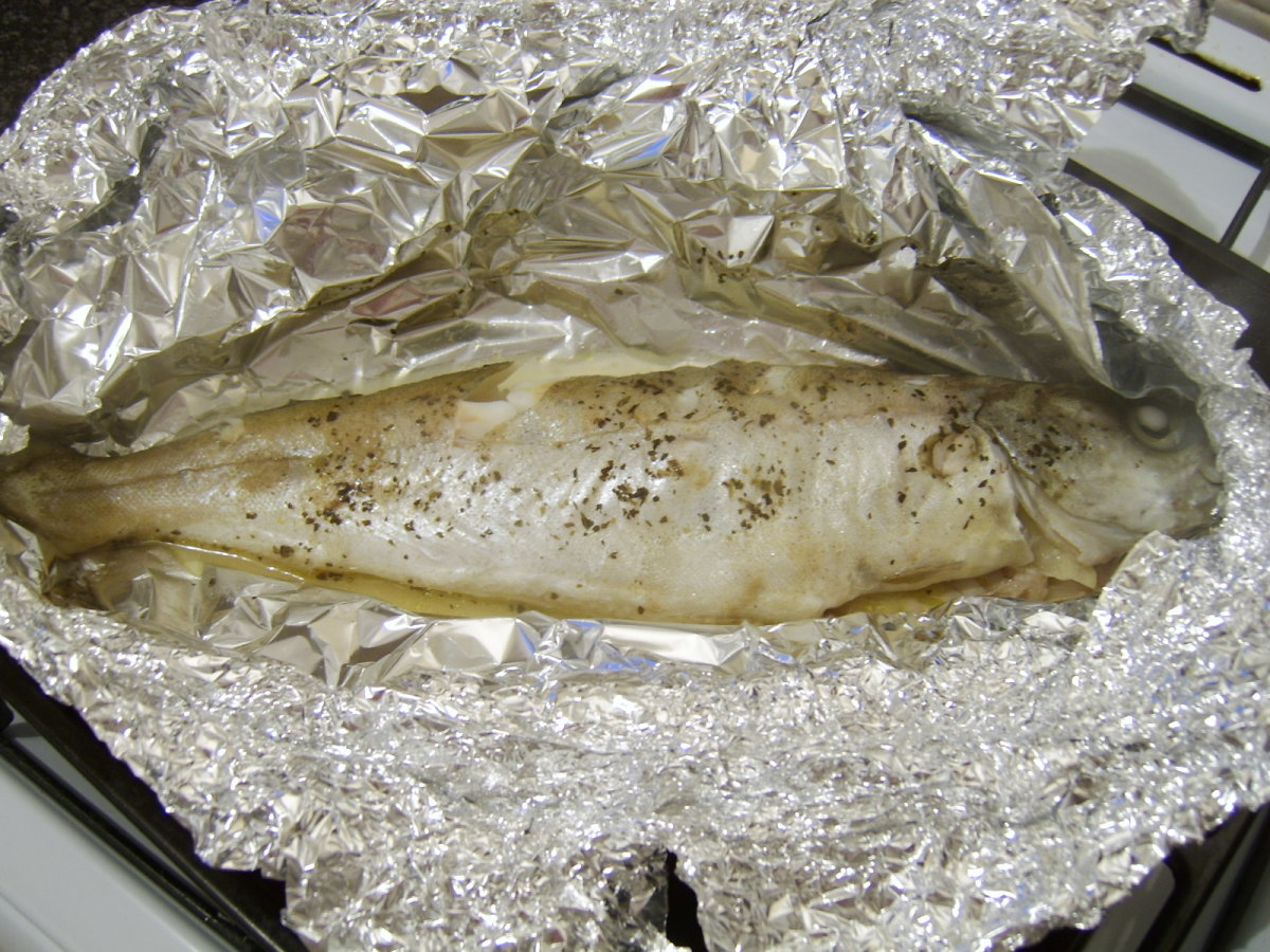 The pollack is removed from the oven and the foil is very carefully unwrapped