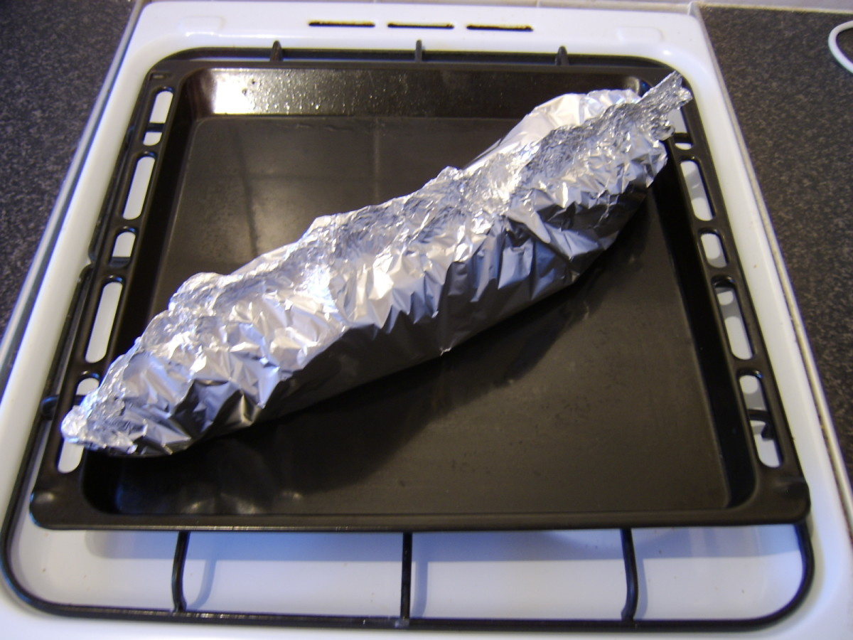 The pollack is wrapped in a sealed but loose foil tent