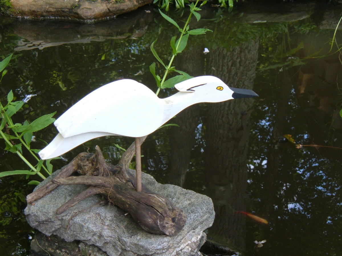 An Egret Decoy Guards Our Pond
