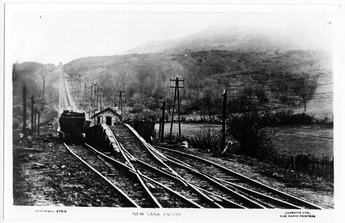 New Bank bottom. laden runaway downward-bound wagons were routed over the hump, the 'Clip Wheel' in the centre of the picture to save them running into Low Drum. The end cottage was demolished by runaways, injuring a miner resting after a night shift