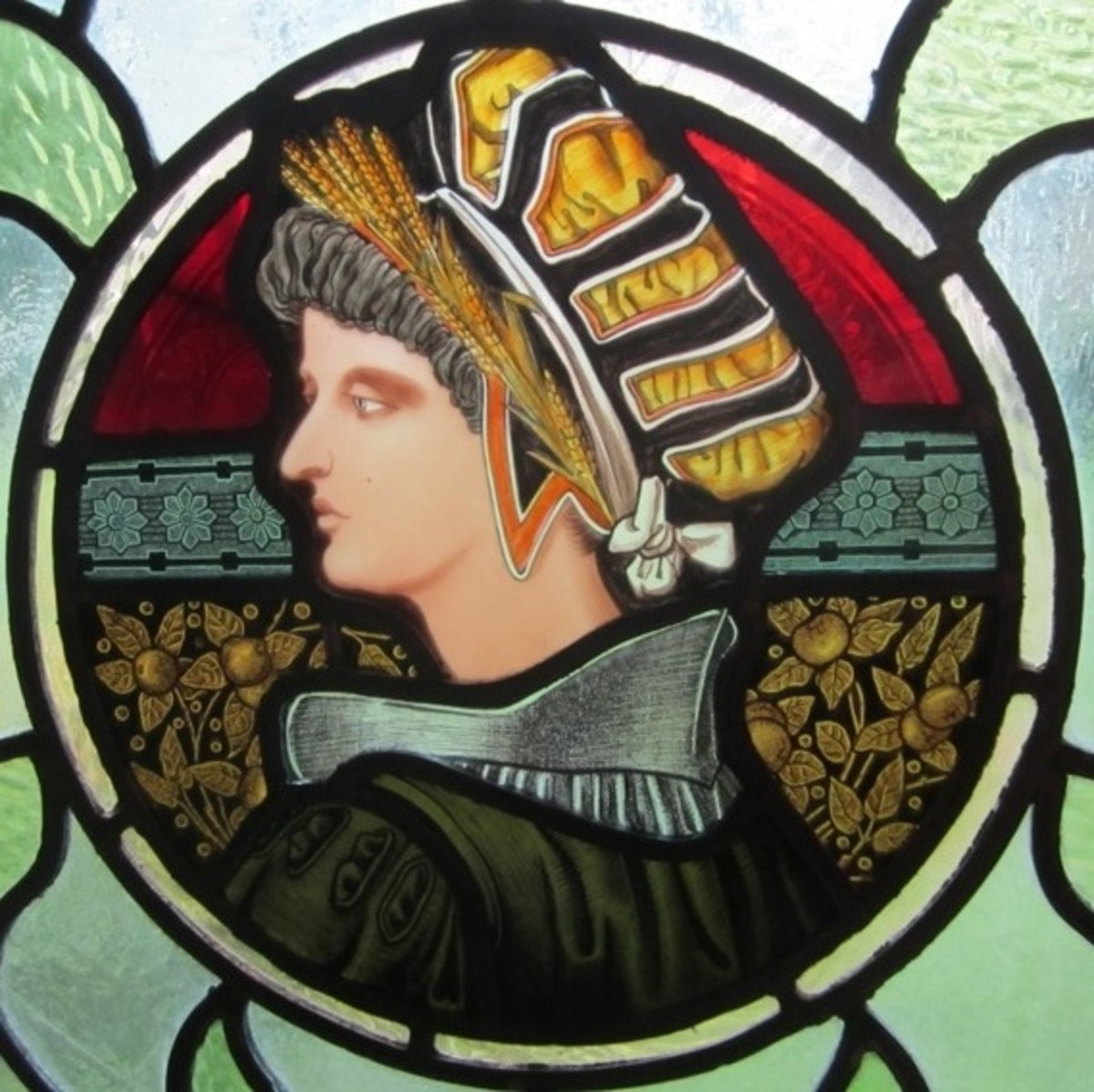 Detail from a stained and leaded glass window used in a Gothic library designed by Restoration Decor and Consulting.